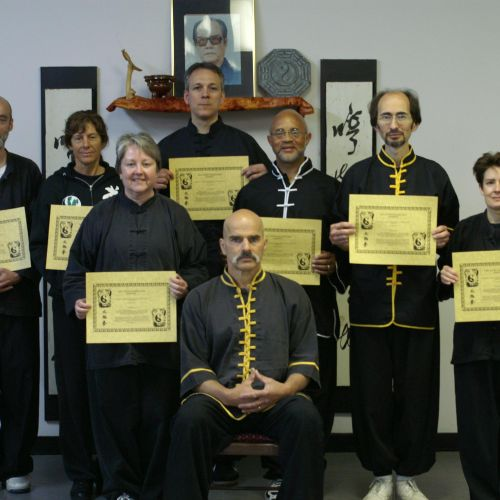 Disciples displaying their teaching certificates. David and I are on the right.