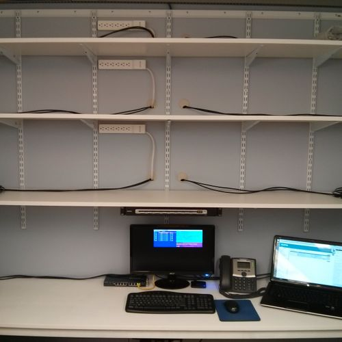 Our laptop repair station allows us to work on up to 16 different laptops at once, connected to conditioned power and an isolated network.