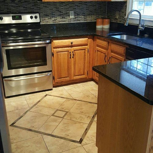 Replaced pink tile on kitchen floor.