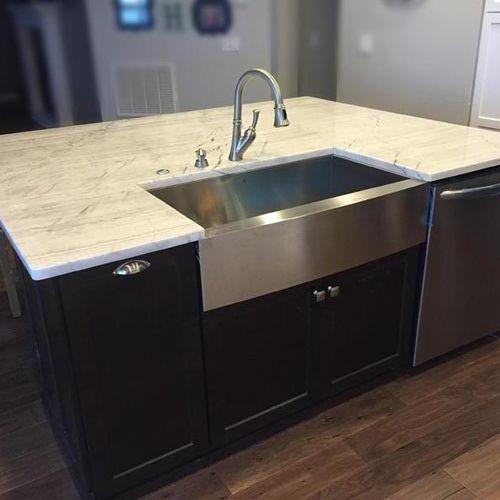 Bianco Emperador quartzite counters in kitchen.