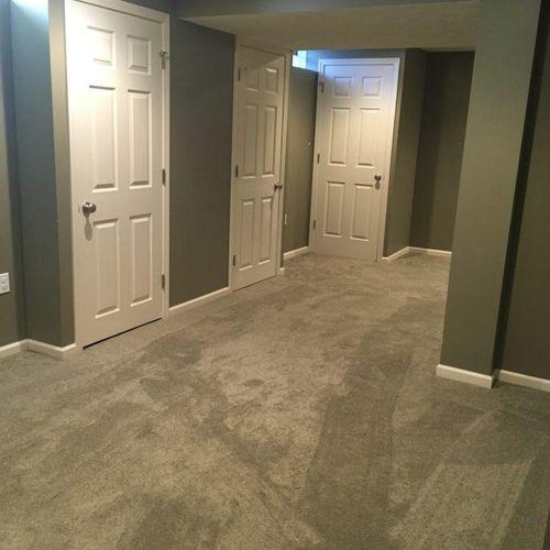 Carpet Installation in Living Room & Basement