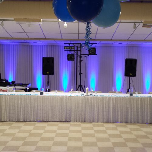Wedding reception set up with blue uplighting at Delmont VFD, Delmont, PA