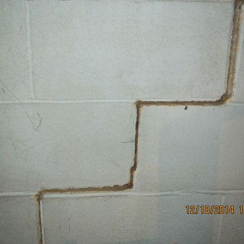Foundation wall cracking and displacement.