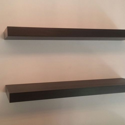 wooden shelves installed concrete wall