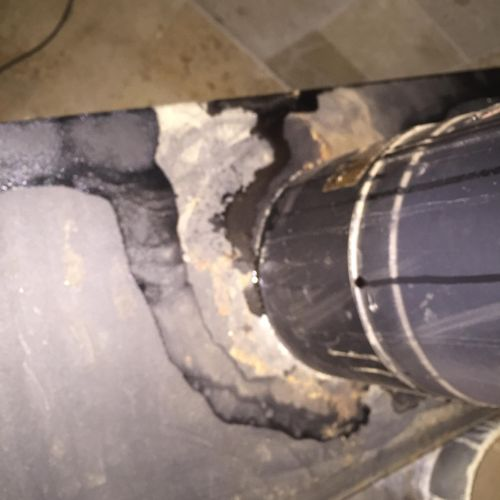 This is a fire hazard created by the stove pipe being installed incorrectly