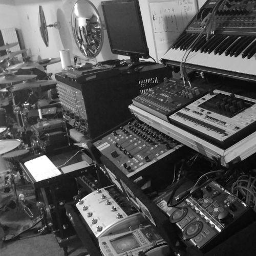 """Studio computer for recording progress and cueing songs. A """"DJ altar"""" to explroe MIDI and beat-making tools."""