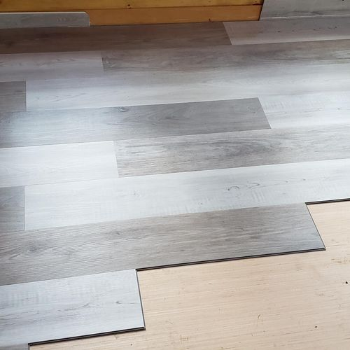 Three season room stage #3. Sub floor and flooring installed after insulation
