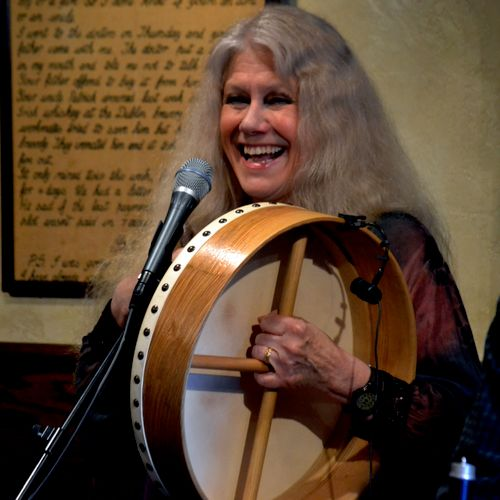 Singing and playing the bodhran