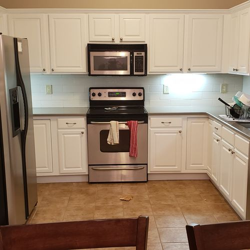 Kitchen After: Painted cabinets, added back splash, and new countertop