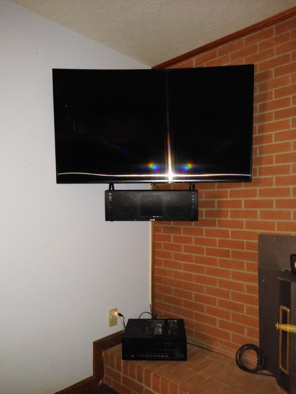 Custom corner 55 TV wall mount with suspended Center Spkr