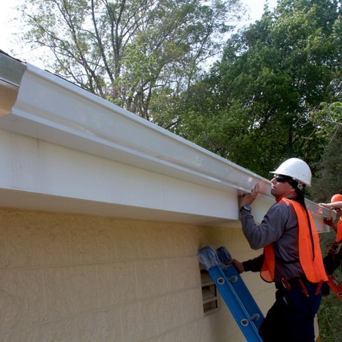 Installing gutters on commercial buildings