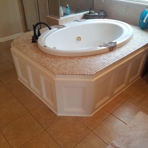 Carpentry work on garden tub.