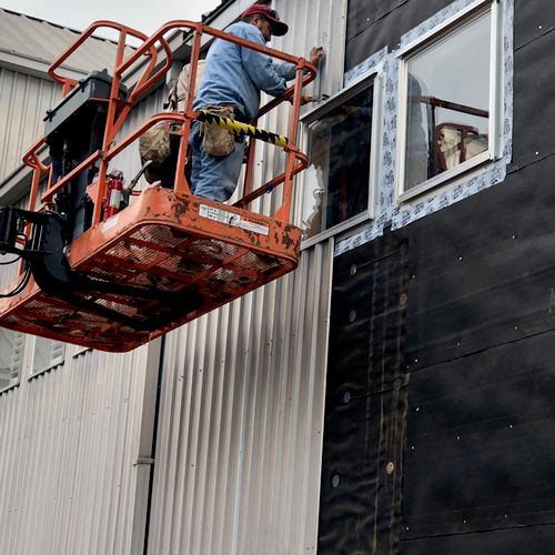 Fire damage exterior repair with new upgrade windows