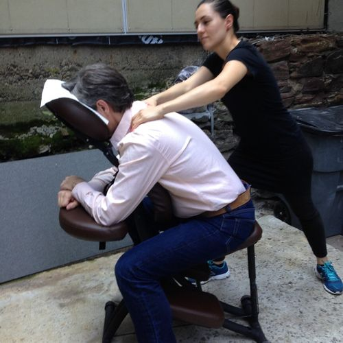 At a corporate event as a massage therapist in NYC