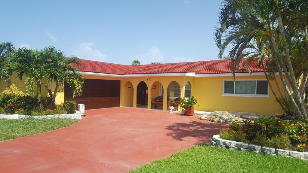 Exterior beach home painting with terracotta roof
