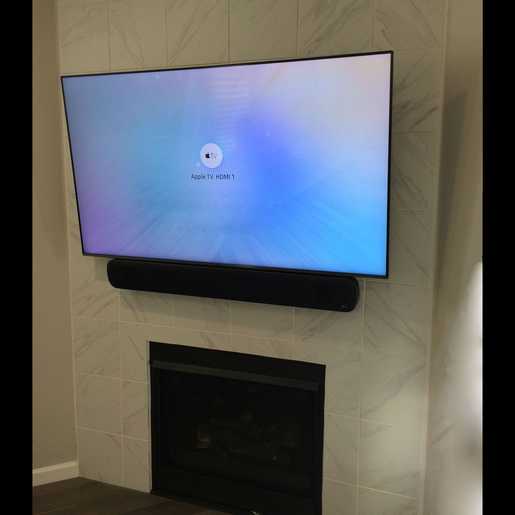 TV Mounted over Fireplace with Tile Backing, Wires Concealed