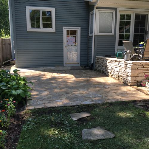 Backyard stone patio and planting