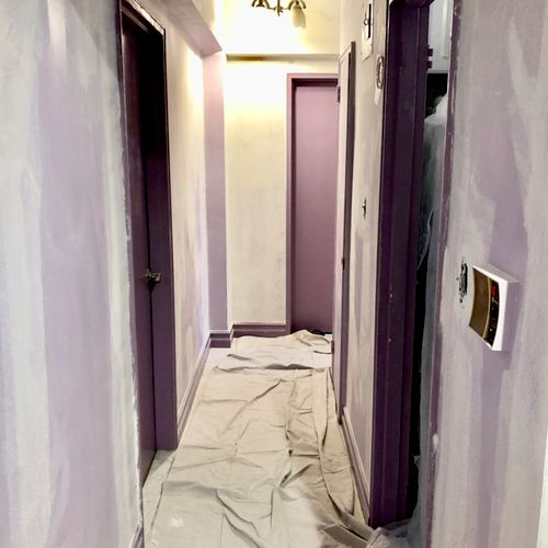 Walls being prepped in the hallway
