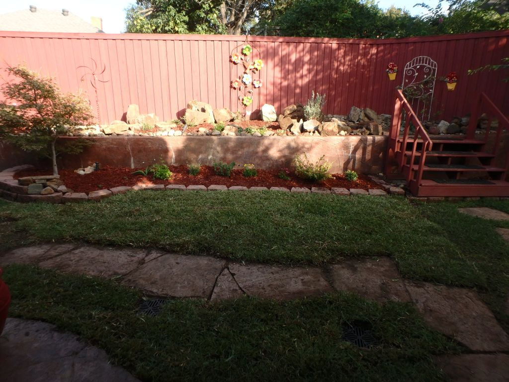 Remove pond, add butterfly garden and some sod, stepping stones