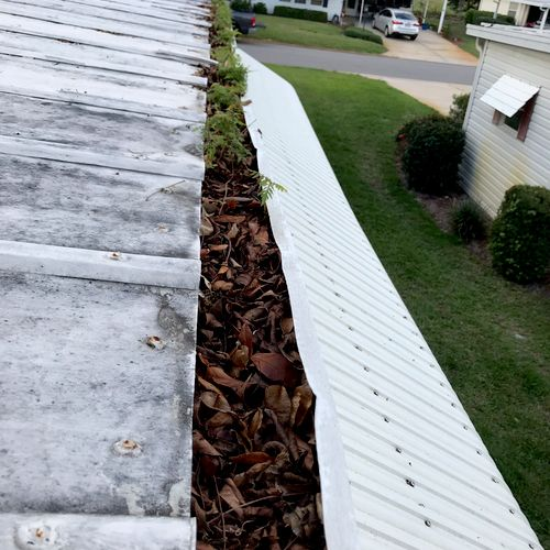 Before gutter cleaning on a manufactured home.