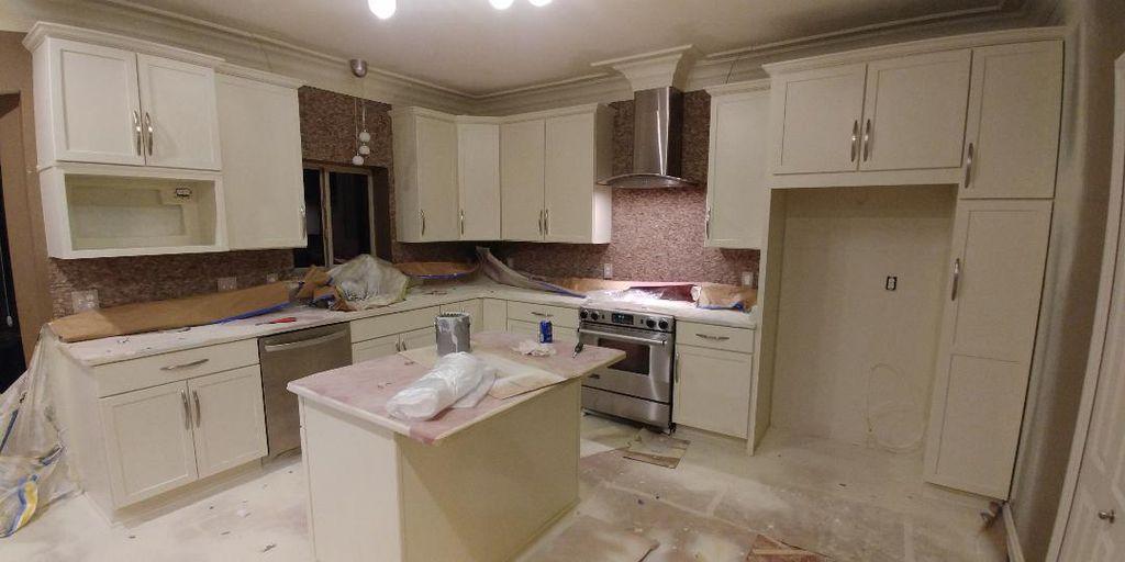 Sprayed refinished kitchen cabinets