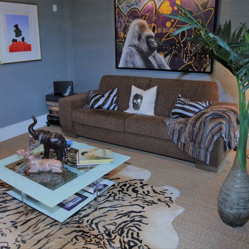 The sofa bed selected for this den in a  condo in  Wayne can become a 2nd bedroom.  See the animal theme pulls design together.