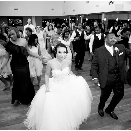 The Robinsons with friends & family on a packed dancefloor during their spring wedding