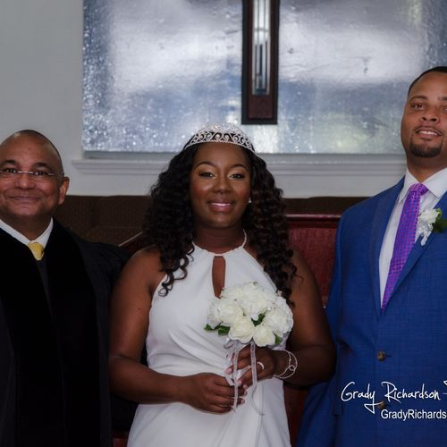 Pastor, Bride, and Groom