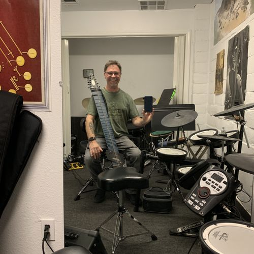 In the teaching studio with my Chapman stick for accompanying drum students.