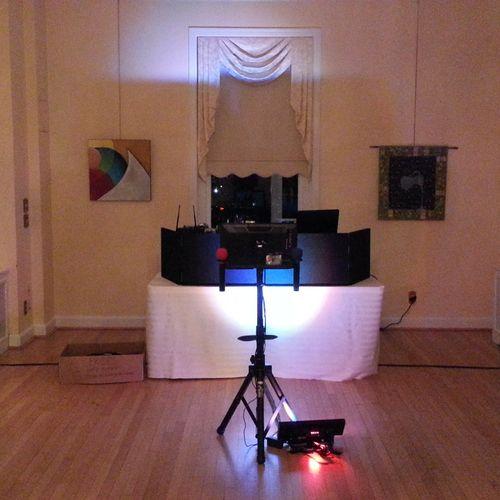 Formal wedding reception KJ setup with accent light