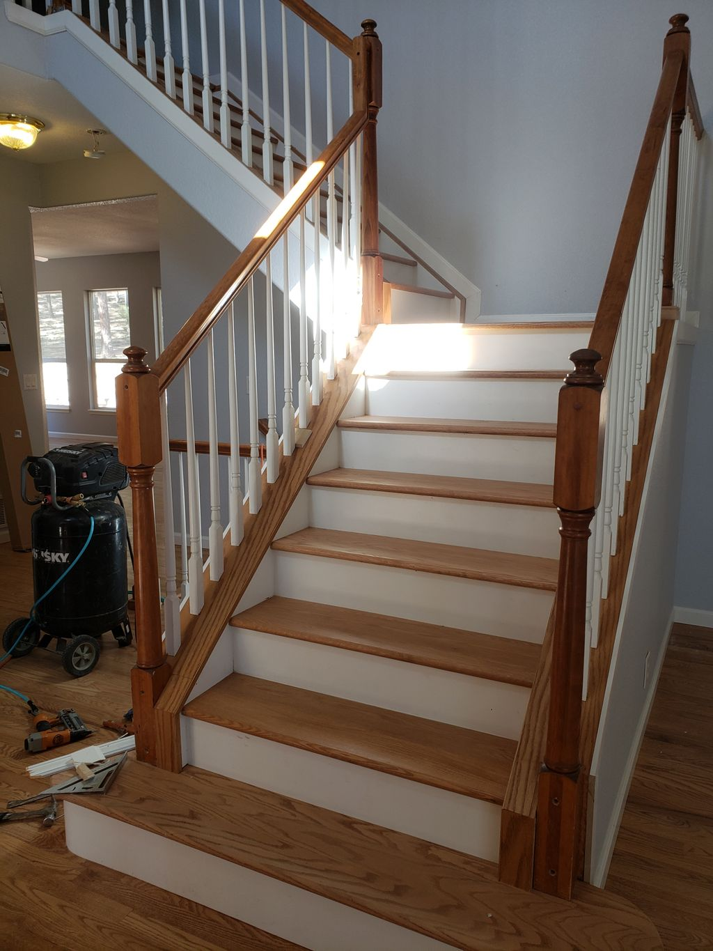 Staircase rebuild and hardwood floor refinishing