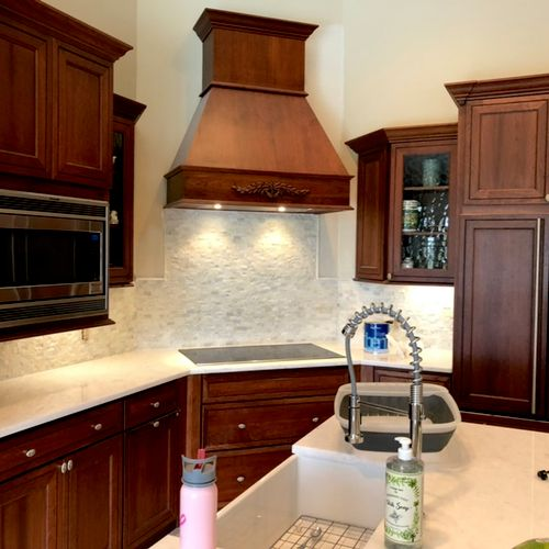Rock face and smooth faced marble mosaic tile kitchen back splash. With marble pencil borders.Existing tile was removed and new board was installed.