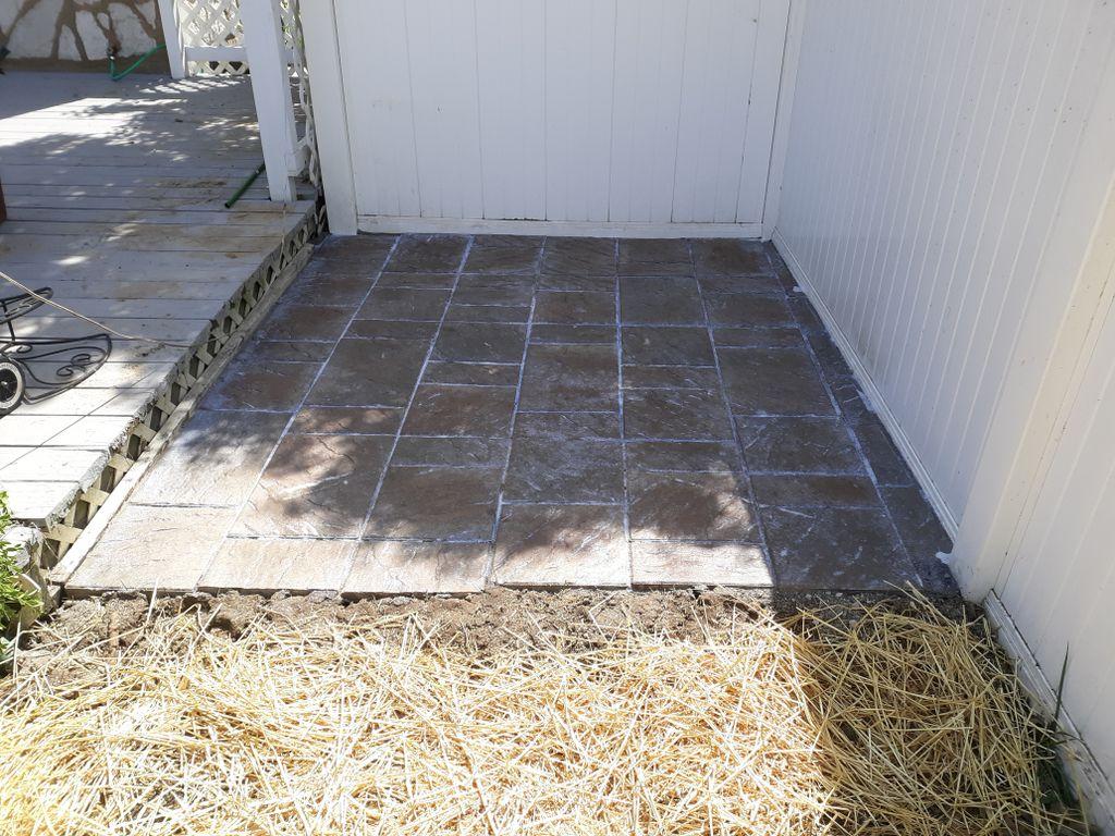 Retaining wall,mulch,plants,paver patio