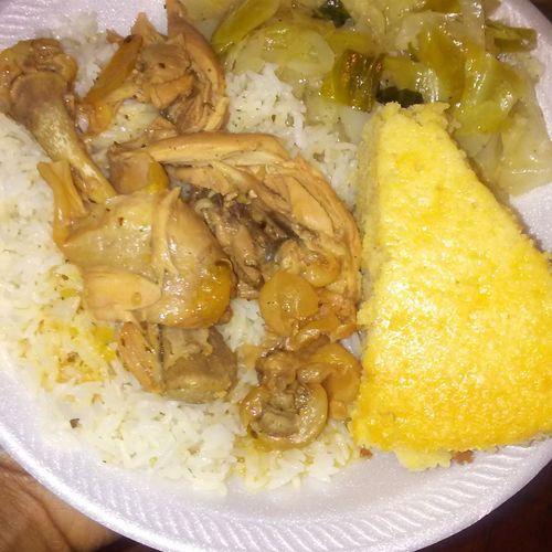 Stewed Chicken over rice w cornbread & cabbage