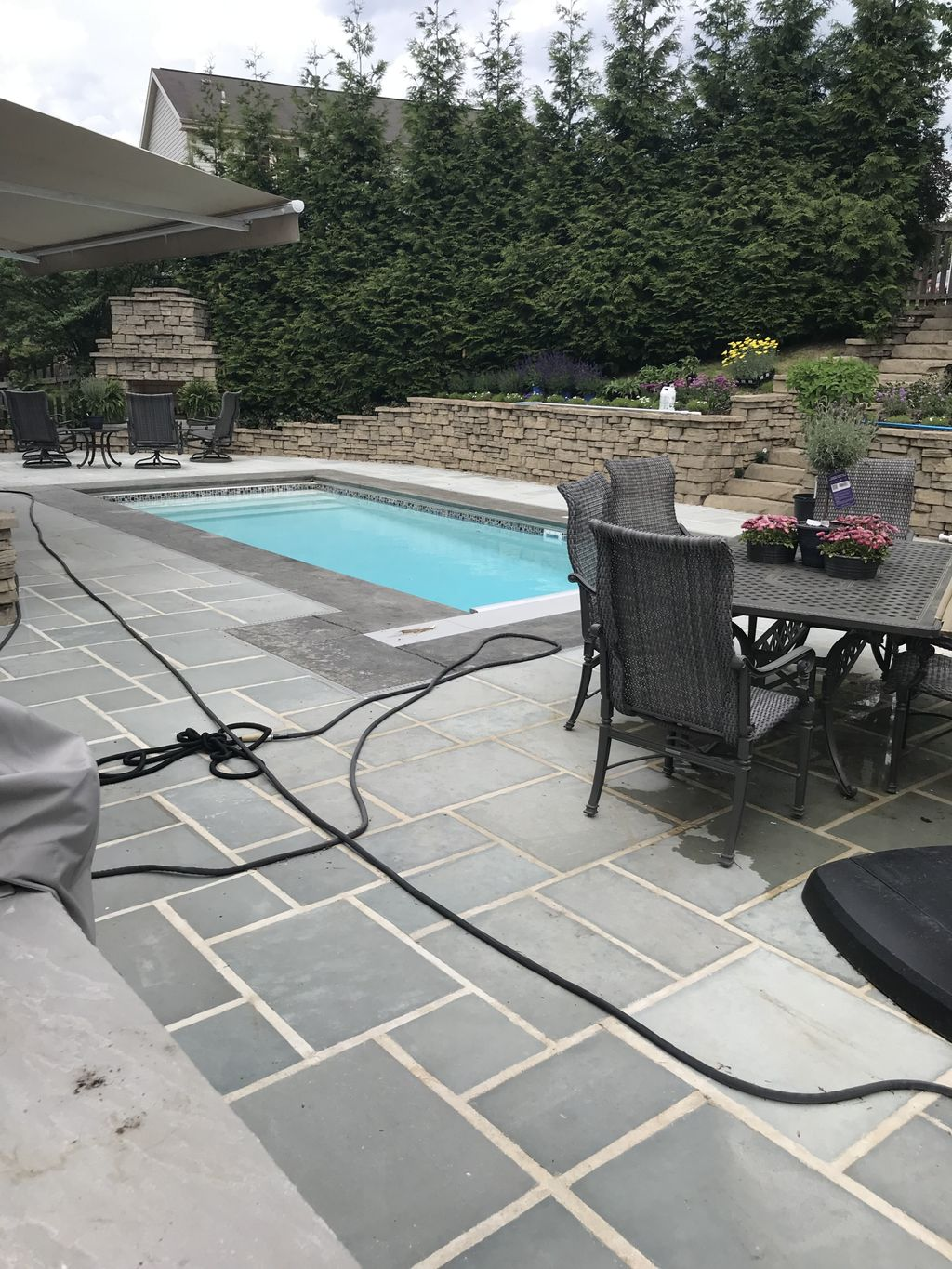 Fireplace, Pavers, Custom roof, Artificial turf, Retaining wall