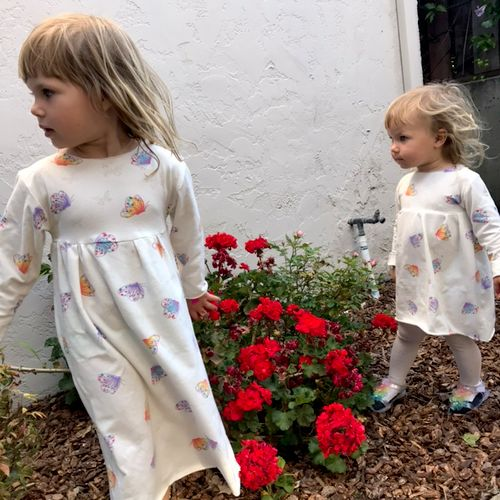 Bunny sisters rocking simple cotton jersey dresses with butterfly pattern.