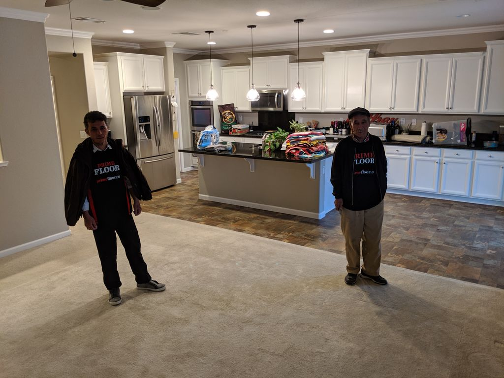 Removal of tile and carpet and installation of vinyl plank