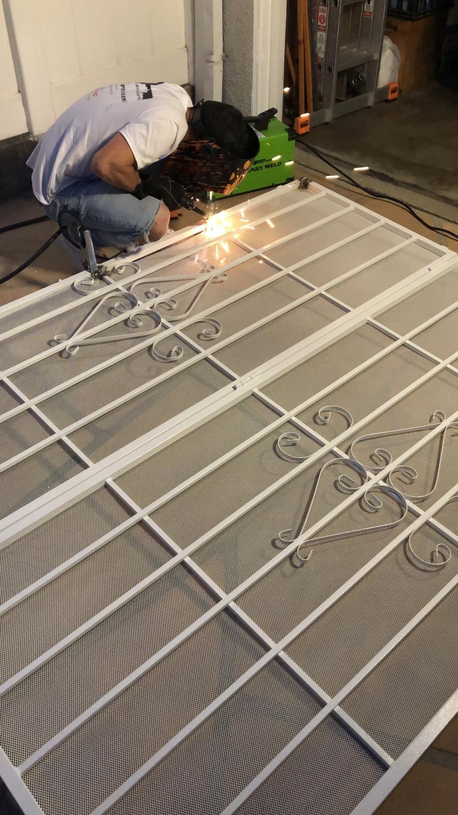 Welding, installing metal screen door