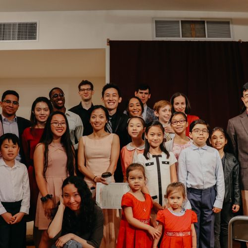 Me with 25 of my students after a student recital at the Soapbox Gallery in Brooklyn
