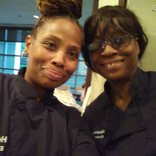 The partners at a catering event
