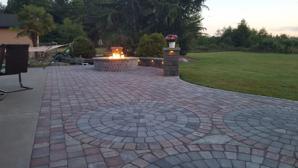 Patio with fire pit and two columns and seating