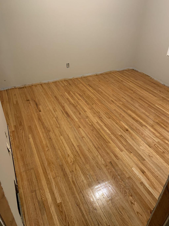 Main floor around 700 sq ft  natural hardwood floor finishing