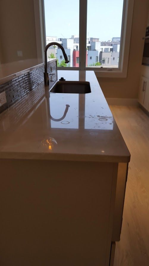 Remove 'water spots' from countertop