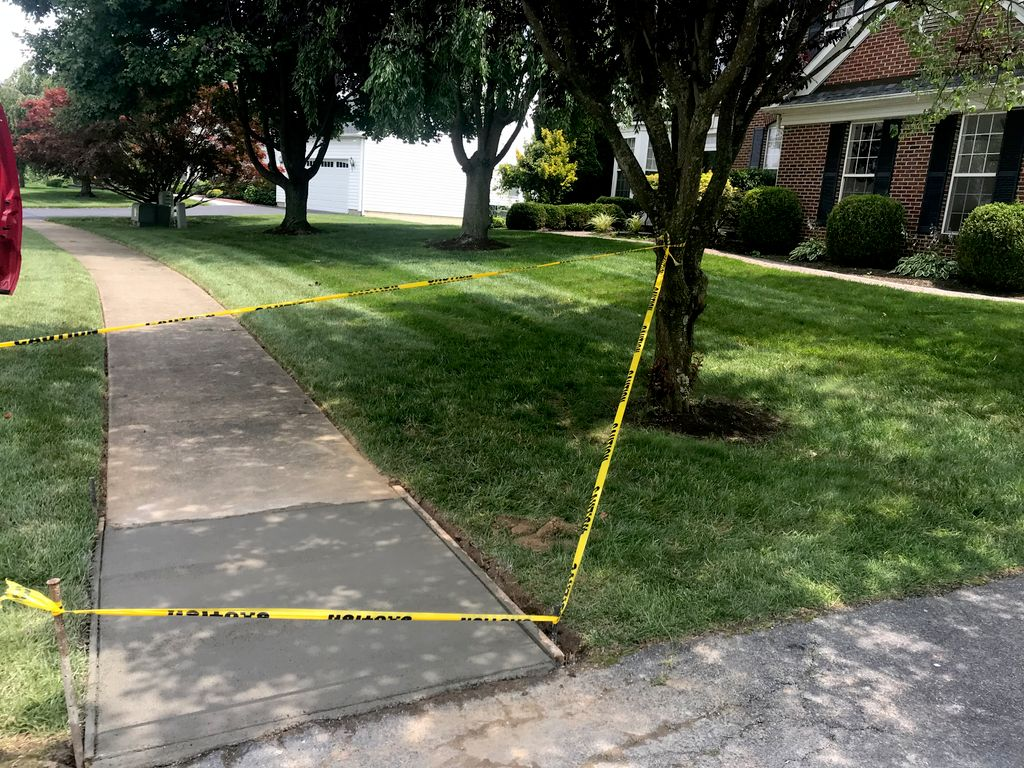Overlay asphalt driveway, and repair concrete sidewalk