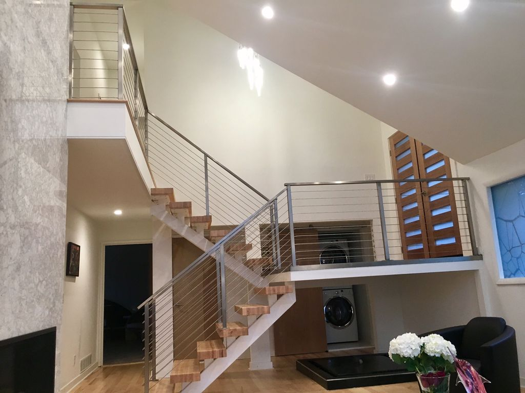 Polish Stainless steel cable railing and metal floating stair