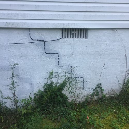 Step cracks indicate significant foundational settlement. Gaps this wide definitely require the help of a structural engineer.
