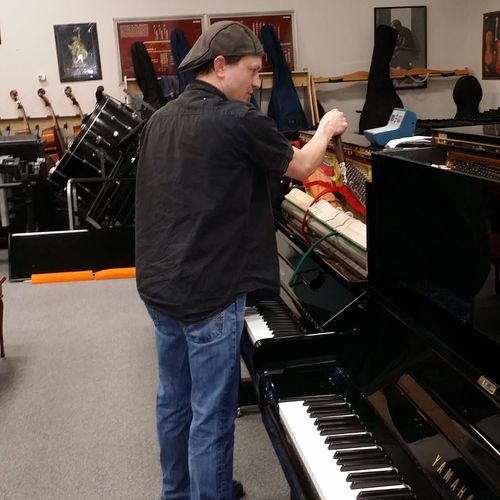 Making sure the pianos are ready to sell!