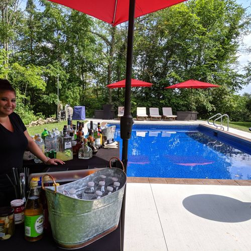 Poolside bar at a private residence. Bartender Gloria