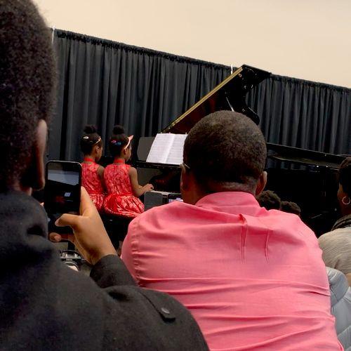 Twins performing a duet at a recital