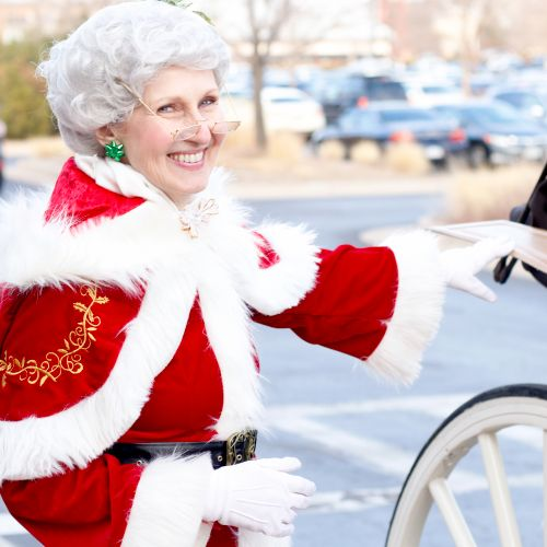 Mrs. Claus helps manage the line